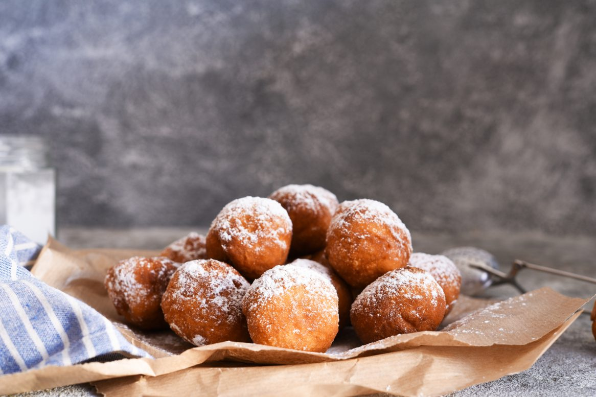 Fried Donuts With Icing Sugar On The Kitchen Table.